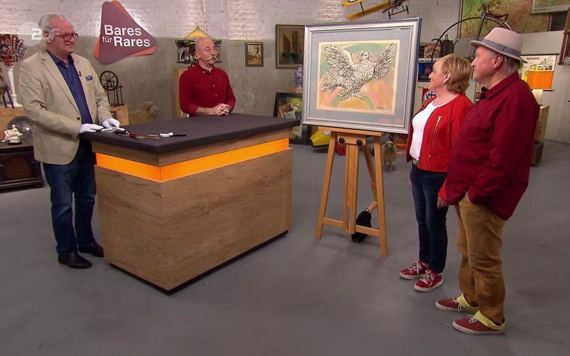 """Ganz verrückte Geschichte bei """"Bares für Rares"""" am Mittwoch: Das Ehepaar Franke aus Langenhagen (rechts) hatte es auf einem Bildermarkt eigentlich nur auf den Rahmen dieses Gemäldes abgesehen. Und im Rahmen? Das steckte ganz zufällig das Werk eines sehr, sehr berühmten Malers ..."""