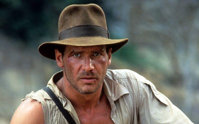 """Harrison Ford, hier 1984 bei den Dreharbeiten zu """"Indiana Jones und der Tempel des Todes"""" zu sehen, verkörpert seit 1981 den Archäologen Dr. Henry Jones."""