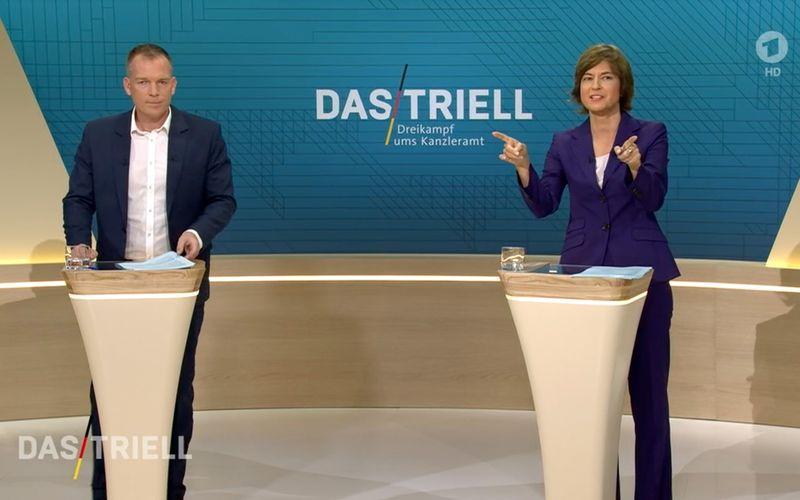 Oliver Köhr (ARD) und Maybrill Illner (ZDF) moderierten das Triell am Sonntagabend.
